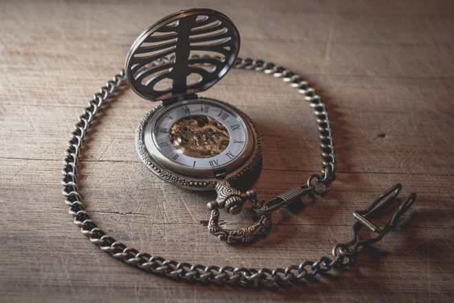 Image of an old pocketwatch with a chain attached to it, represents that using lodash's chain is faster sometimes than using the native map, filter and reduce.